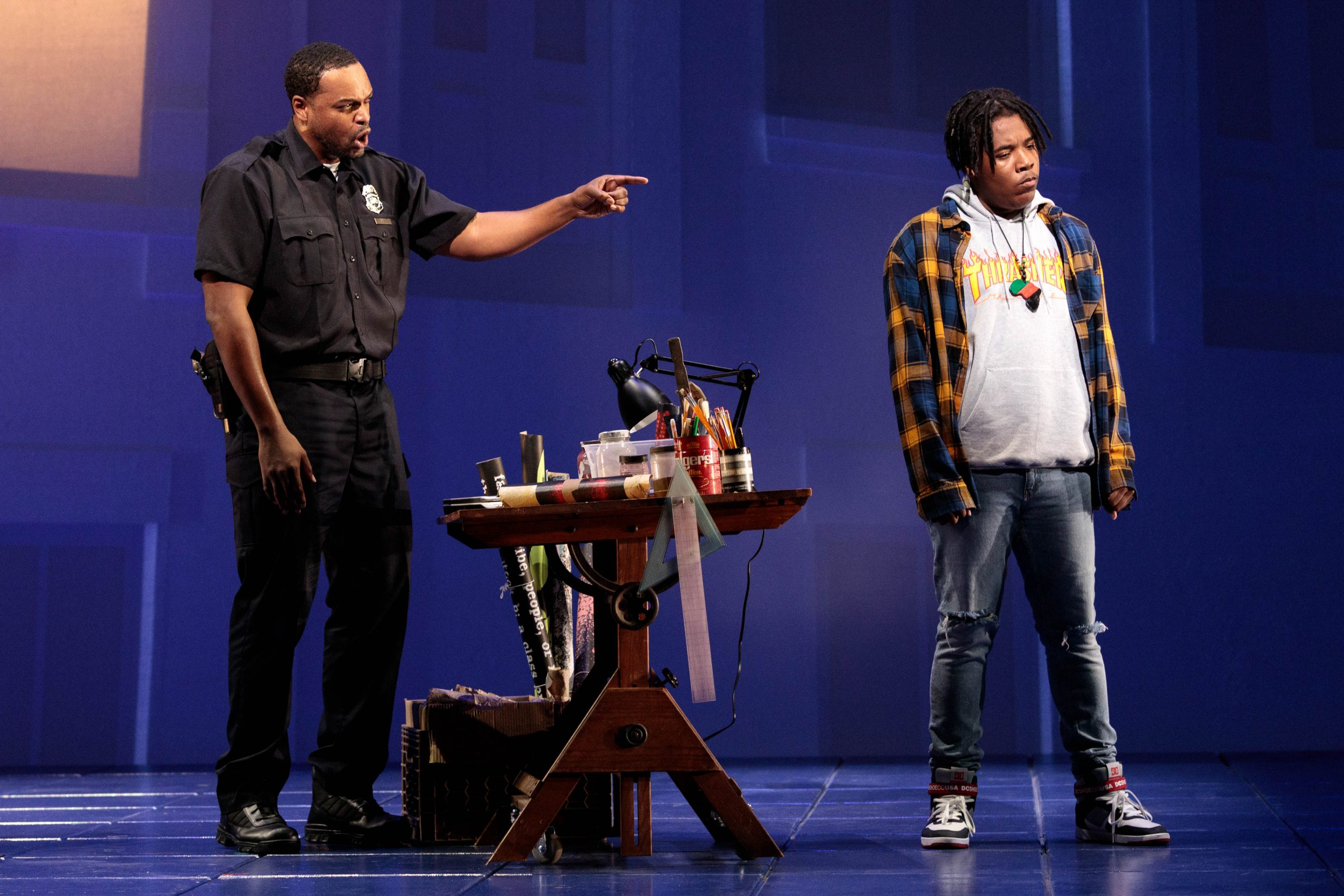 Father points at son in the 2019 production of Blue.