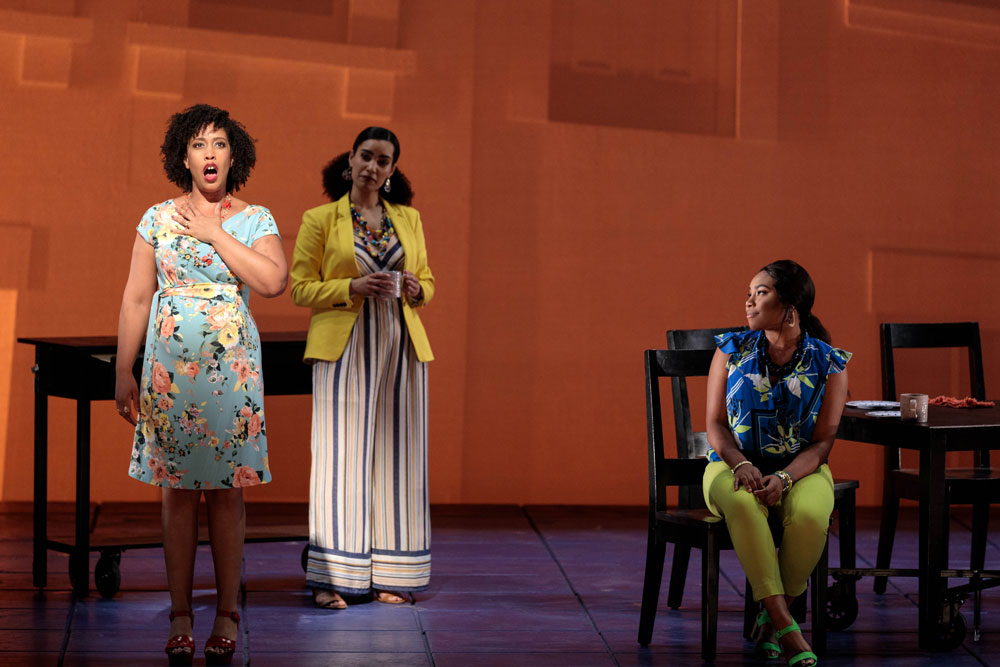 Three women converse on stage for the 2019 production of Blue.