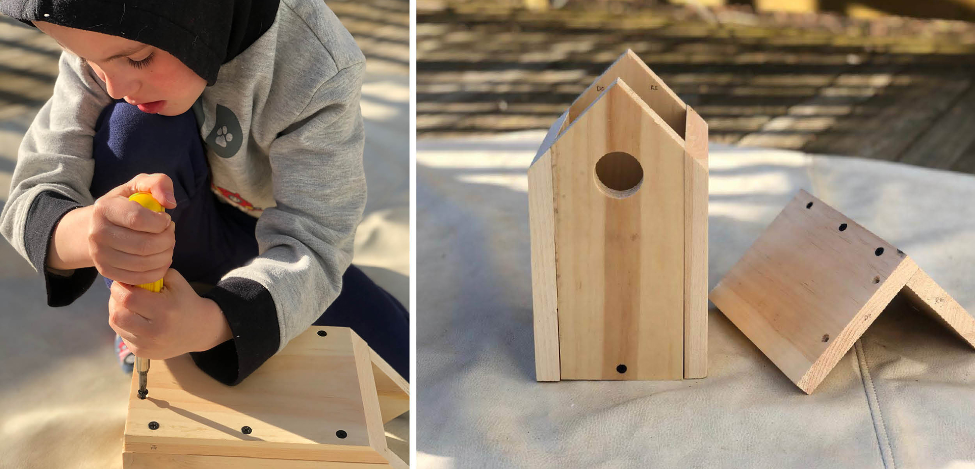 Young person in a hooded sweater assembles a birdhouse out of wood using a screwdriver.