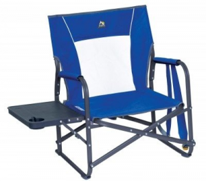 a blue folding chair with attached table